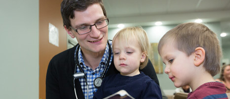 Doctors working with children.